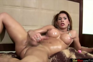 Big ass shegirl shakes up her shaft and fondles oiled body