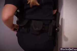 Big cocked black stud banging two busty female cops