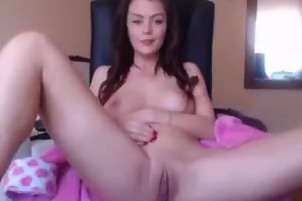 Cute girl masturbates on the chair