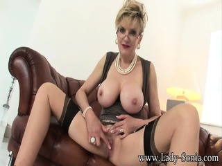 Mature Lady With Big Boobs Rubs Her Cunt