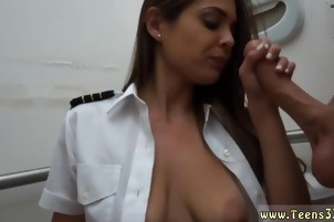 Busty brunette blows his huge cock in the bathroom