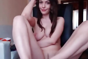 Brunette shows her pussy on the chair