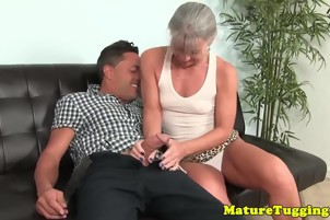 Glamorous busty cougar jerking off hard cock
