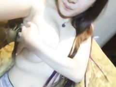 sexy chinese nubile showcases off her good-sized tits
