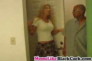 Beautiful milf with big tits rides long black cock