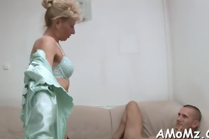 Hot MILF welcomes her step-son home