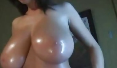 Hot stripteasing brunette with big oily tits teasing on webc