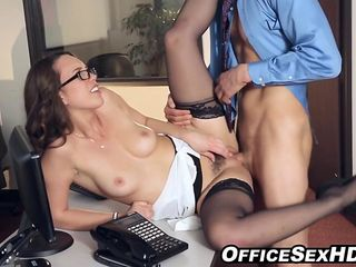Naughty secretary in stockings office sex with her boss on desk