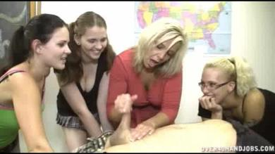 Blonde teacher showing pupils how to give BJ