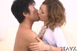 Adorable Japanese in stockings gives explicit blowjob delight