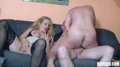 A FFM threesome features platinum blonde German slut in her 40s having sex