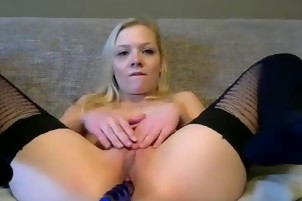 Blonde shows her small tits at live
