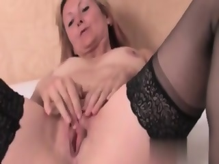 Horny Blonde Milf In Black Stockings