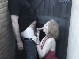 Homemade - Mature woman in red in the allyway