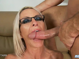 blond milf sits on a yam-sized fuckpole and gets face drenched in spunk