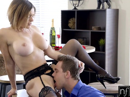 Awesome lady with huge funbags is dressed in stocking and garter belt while hotwife on her colleague