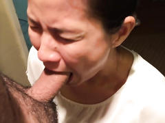 Asian girl blowing cock on her knees