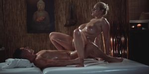 Massage Rooms Sexy MILF with huge natural tits gives oily tit wank