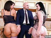 Bald headed dude fucks two big bottomed and big tittied whores