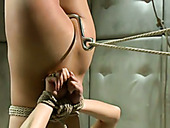 Suspended porn actress Marica Hase takes hook in her anal hole