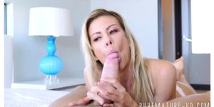 Buxom blonde cougar rides cock