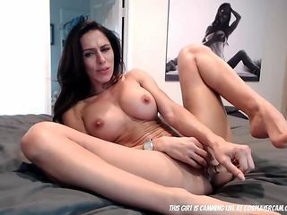 Pretty fitness MILF filling both her holes