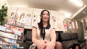 Japanese adult star in pantyhose plays with a fan