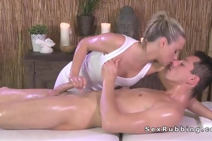 Blonde masseuse giving cock massage in oil
