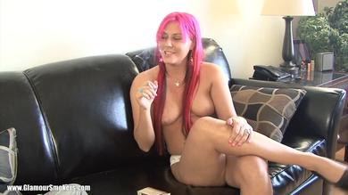 Victoria S. naked on a couch ferociously smoking a cigarette