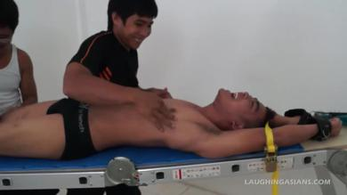 Laughing Asians: tied Asian twink is teased and tickled for gay fetish show