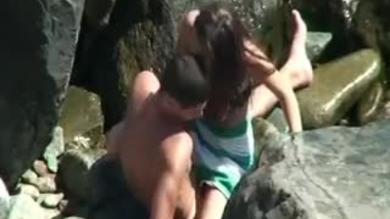 Amateur young couple caught on hidden cam having sex on the beach