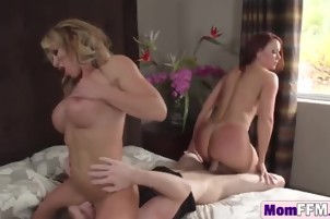 Redhead and blonde cougars satisfying one young guy