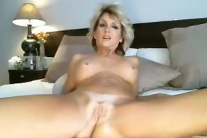 Hot milf puts a dildo inside her ass and pussy